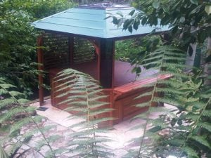 Moult gazebo and spa in garden setting